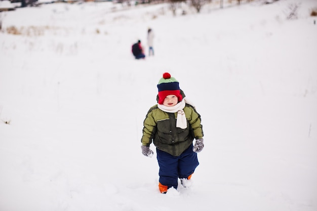 Little boy is running somewhere in the snow Free Photo