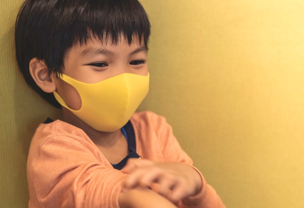 Little boy is wearing healthy mask protection from flu Premium Photo