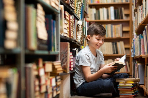 Little boy at library Free Photo