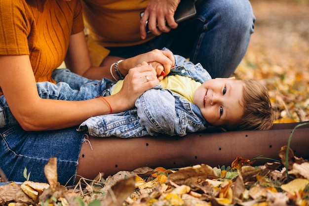 Little boy lying on mother's knees in park Free Photo