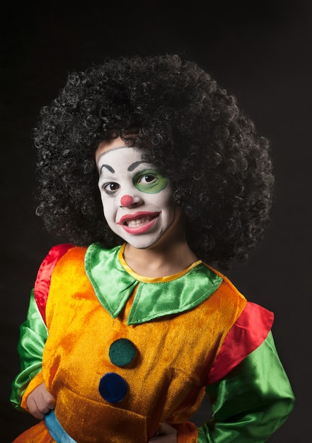 Little boy, make-up of the clown, the african Premium Photo