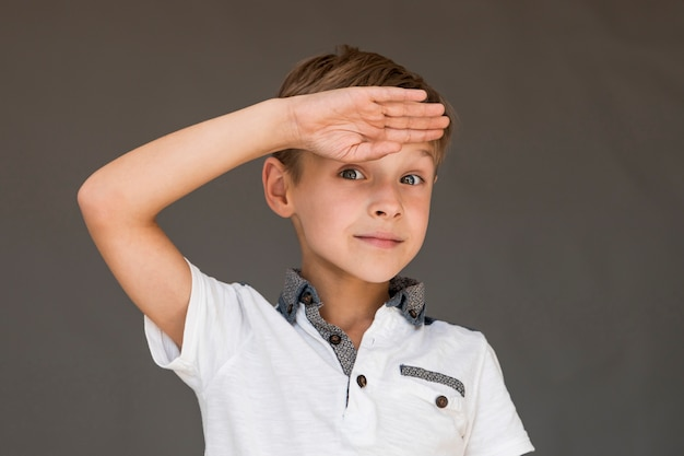 Little boy making a soldier salute Free Photo