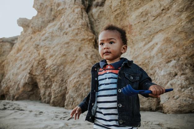 Little boy playing at a beach Premium Photo