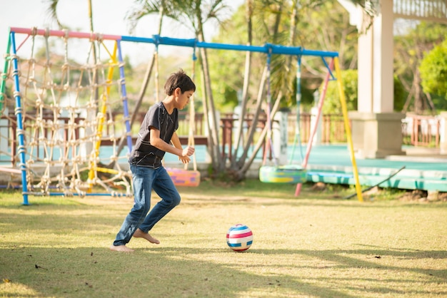 Little boy playing in the playground outdoor Premium Photo