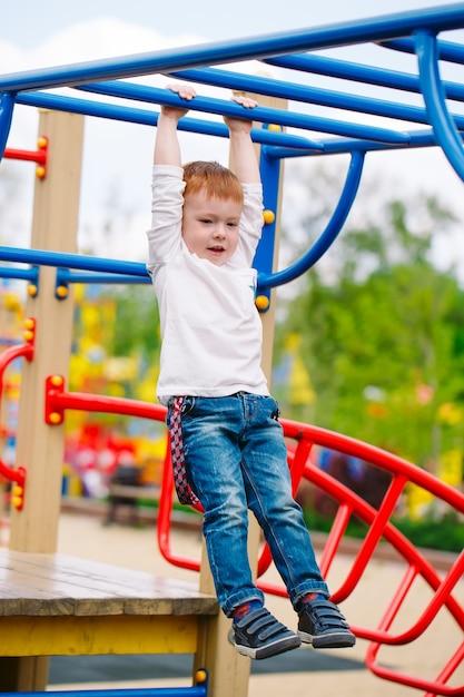 Little boy playing on the playground. Premium Photo