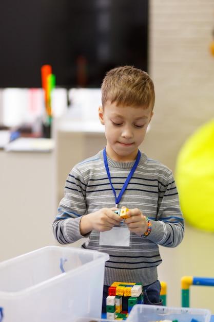 Little boy playing with blocks Premium Photo