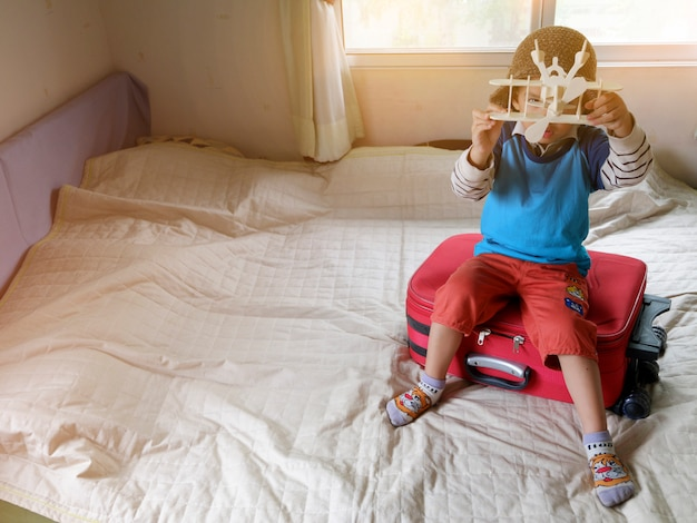 Little boy playing with toy airplane,travel and adventure concept Premium Photo