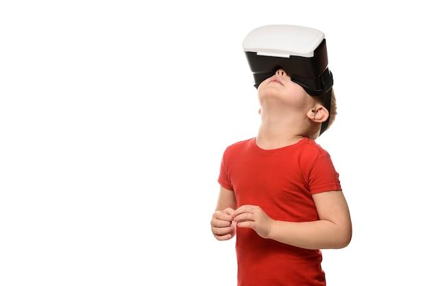 Little boy in red shirt experiencing virtual reality raising his head Premium Photo