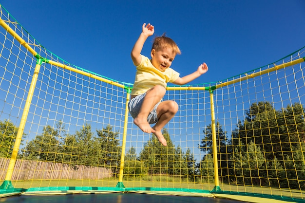 Little boy on a trampoline Premium Photo