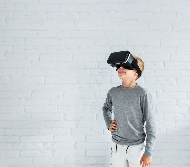 Little boy using virtual reality glasses Free Photo