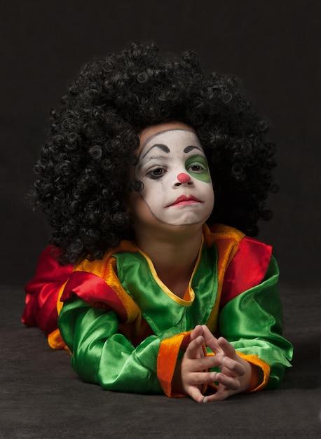 Little boy with clown make-up Premium Photo