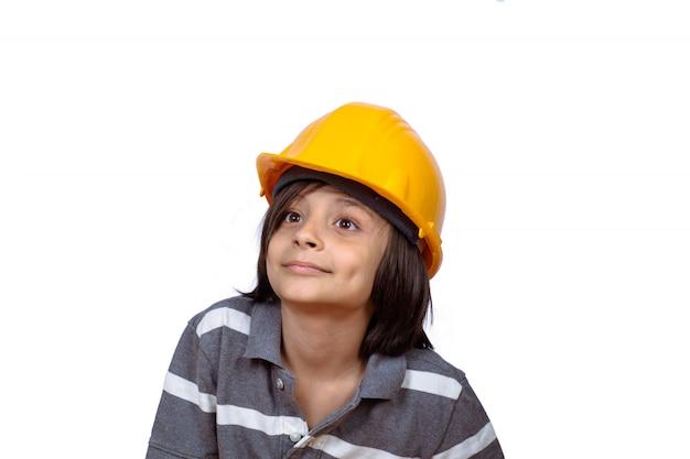 Little boy with construction helmet. Premium Photo
