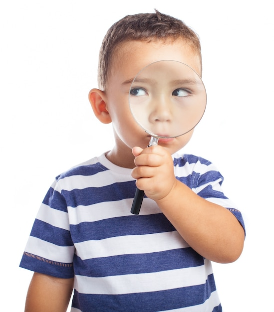 Little boy with a magnifying glass Free Photo