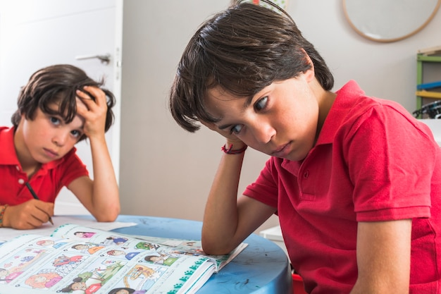 Little brothers study together Free Photo