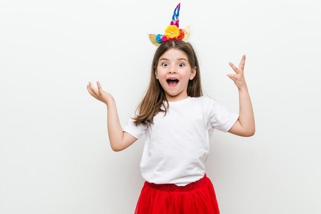 Little caucasian girl with costume and accessories having fun Premium Photo