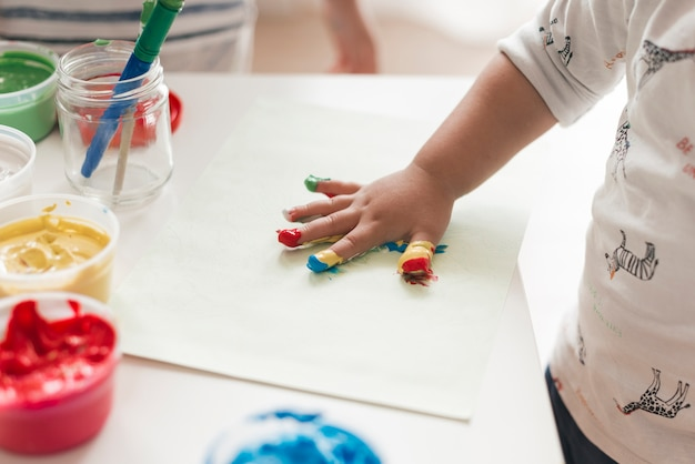 Little child painting like an artist Free Photo