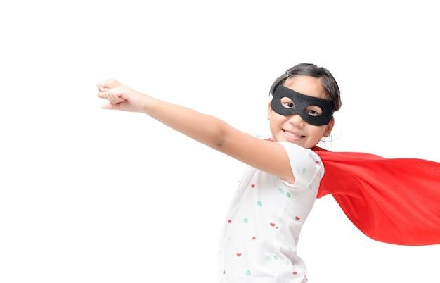 Little child plays superhero isolated on white Premium Photo