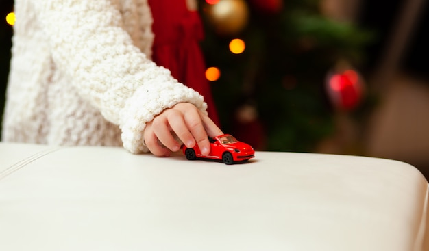 Little child plays with little toy car. Premium Photo