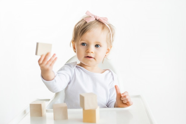 Little child shows wooden block. children educatoinal by the montessori method. eco friendly wood t