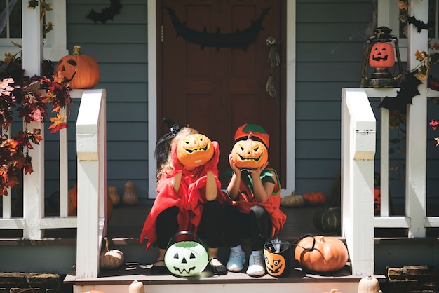Little children in halloween costumes Free Photo
