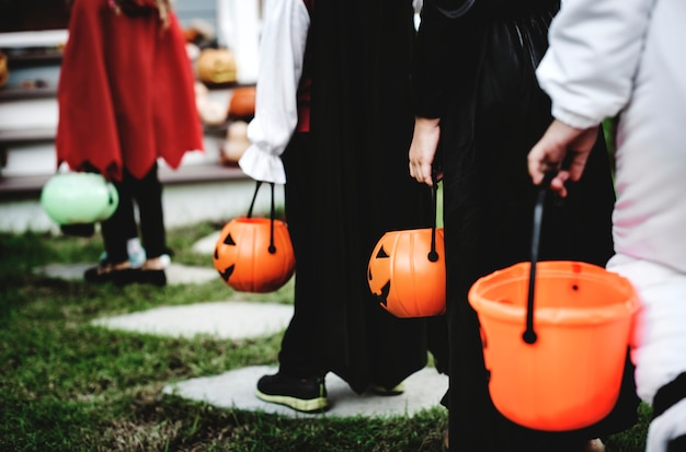 Little children in halloween costumes Premium Photo