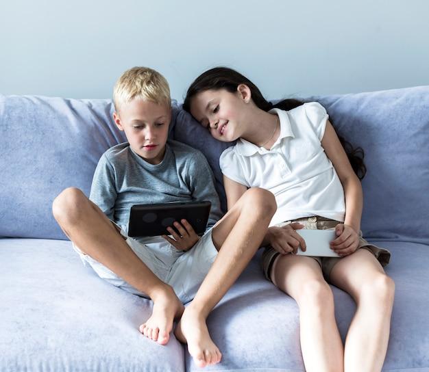 Little children using new technologies Free Photo