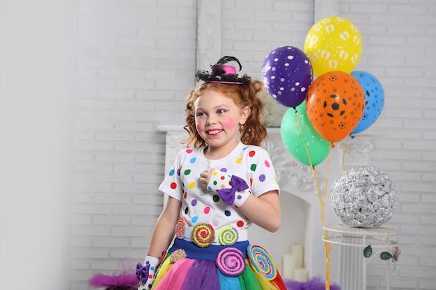 Little clown with balloons. Premium Photo