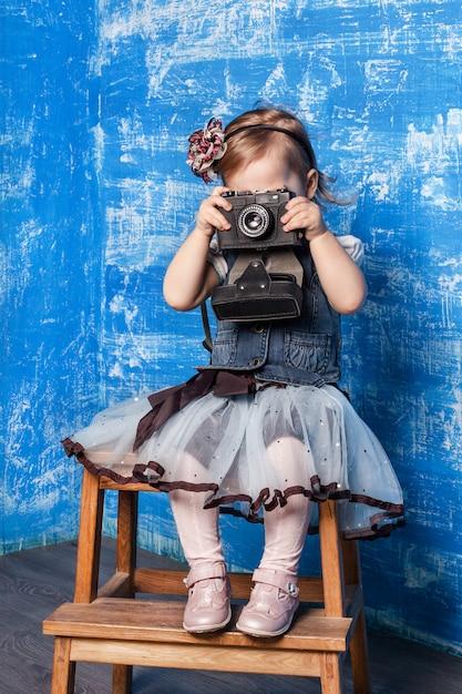 Little cute girl takes a photo Premium Photo