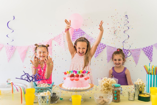 Little cute girls having fun while celebrating birthday party Free Photo
