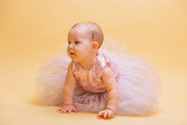 Little cute toddler in dress Free Photo
