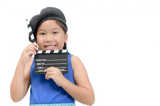 Little director holding clapper board or slate film Premium Photo