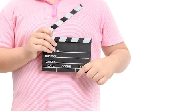 Little director holding  slate film for making video cinema Premium Photo