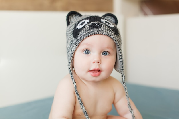 698aa46d9 Little funny baby boy with big blue eyes smiling with cute cap with ...