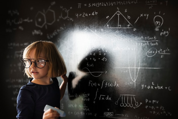 Little genius drawing up some science Premium Photo