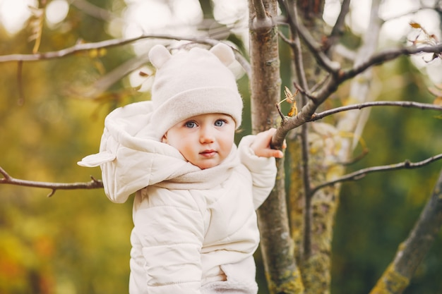 Little girl in a autumn park Free Photo