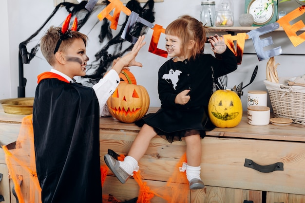 Little  girl and  boy are  scary each otherhalloween Premium Photo