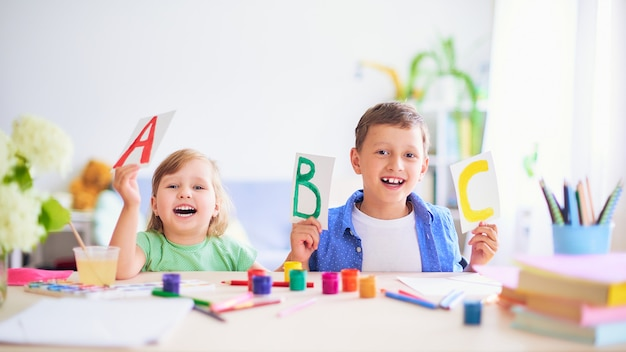 A little girl and a boy learn at home. Premium Photo