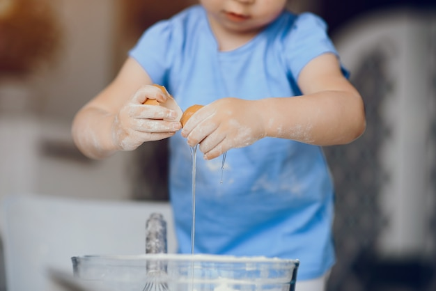 Little girl cook the dough for cookies Free Photo