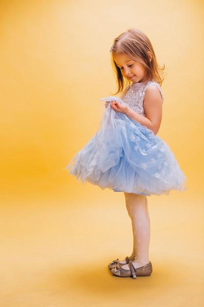 Little girl in cute dress Free Photo