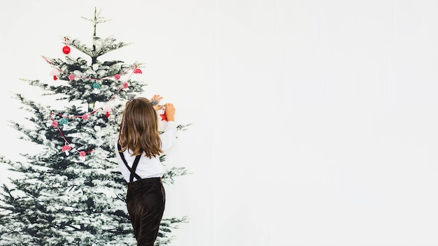 decorating with christmas little girl decorating christmas tree photo free download