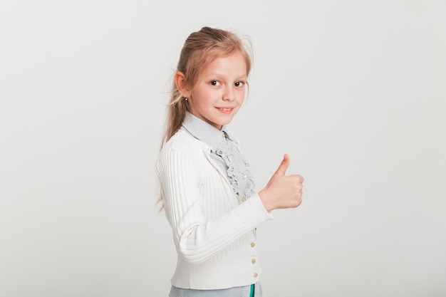Little girl doing thumbs up Free Photo