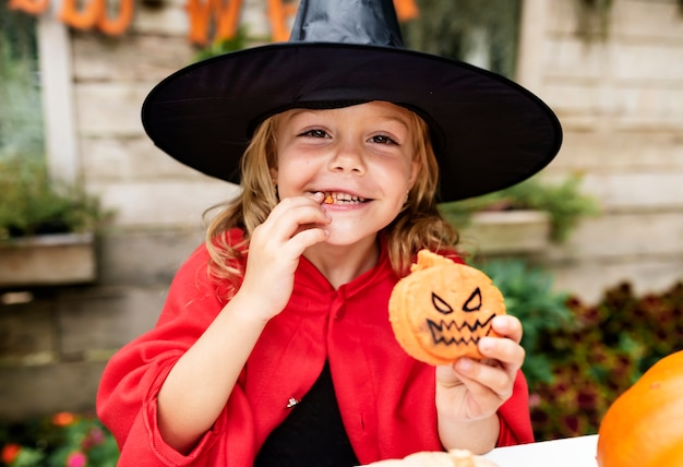 Little girl dressed up as a witch Free Photo