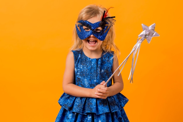 Little girl in fairy costume with mask and wand Free Photo