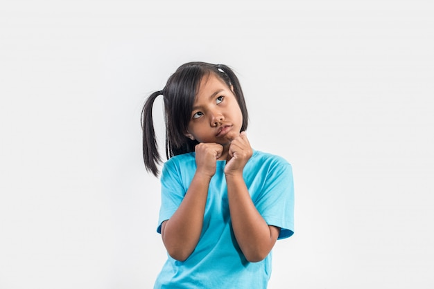 Little girl feel angry in studio shot Free Photo
