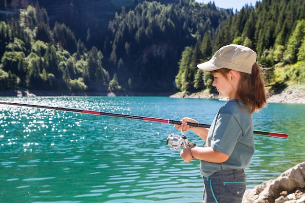 Little girl fishing in the mountains Premium Photo
