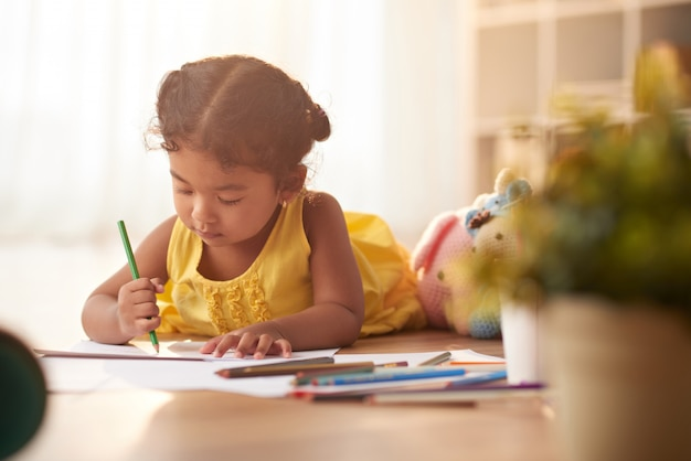 Little girl focused on drawing Free Photo