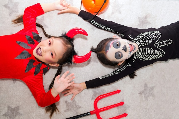 Little girl in halloween carnival costume with jack Premium Photo