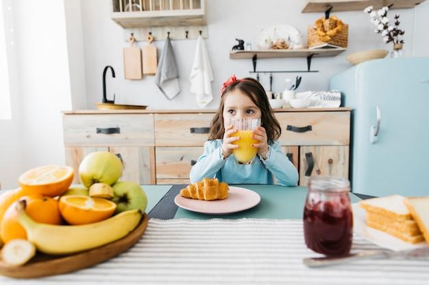 Little girl having her breakfast Free Photo