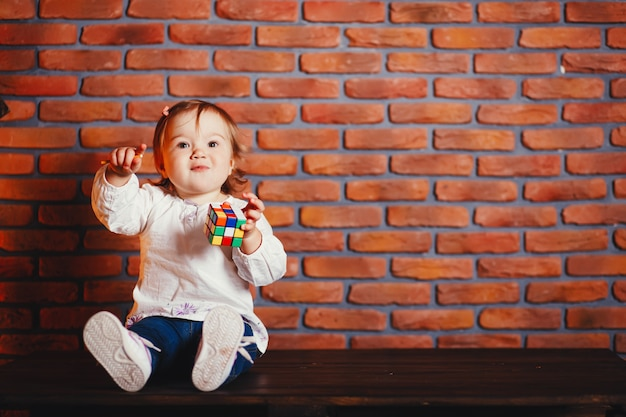 Little girl at home Free Photo