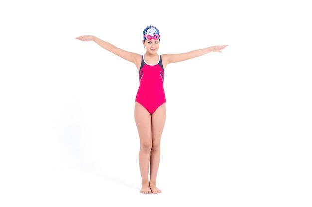水着とキャップの少女 Premium写真